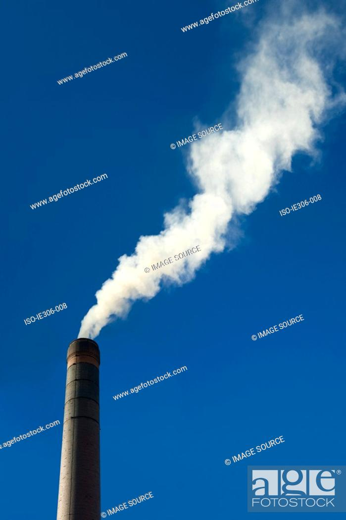 Stock Photo: Smoke coming from a chimney.