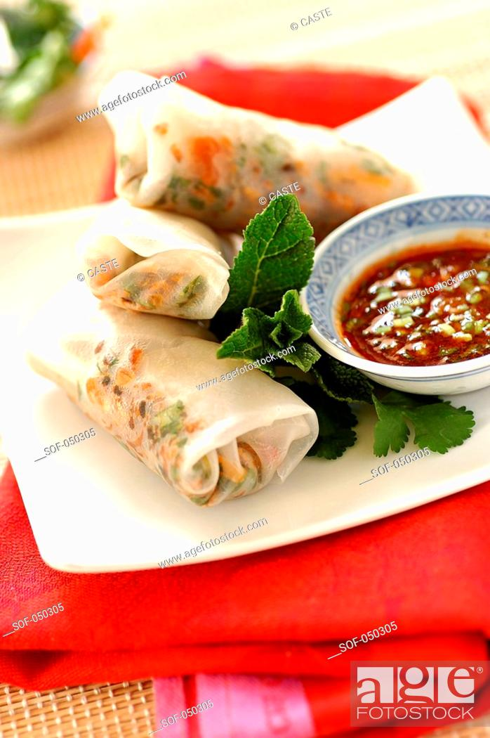 Stock Photo: spring rolls with caramelized flaked salmon.