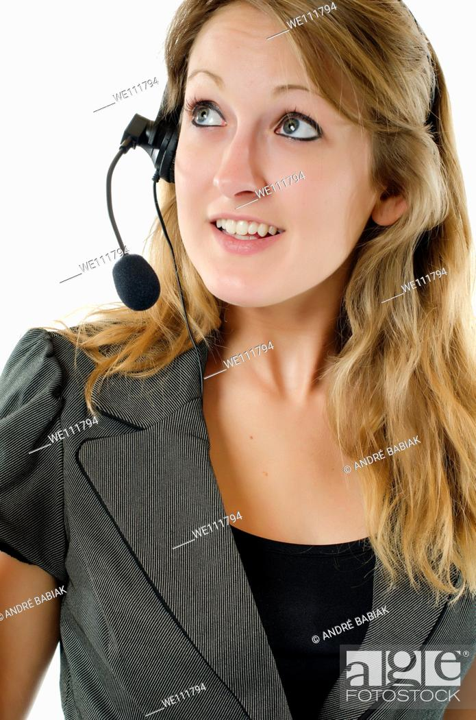 Stock Photo: Young woman with headset doing phone support.