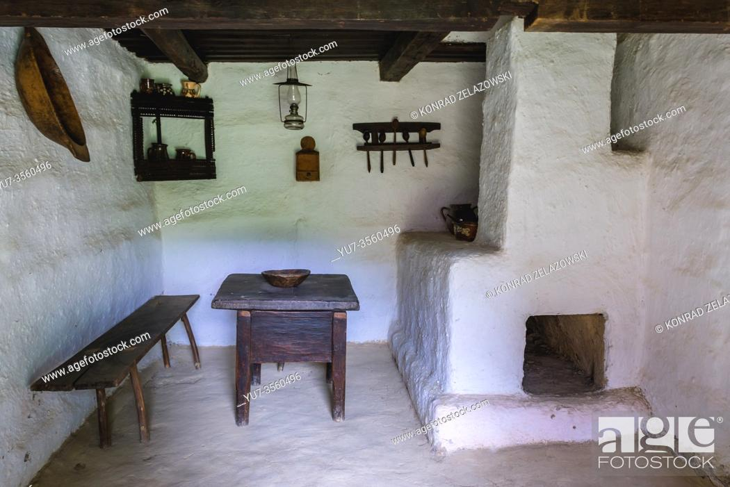 Stock Photo: Interior of traditional cottage in Oas Village Museum located in Negresti-Oas town in the county of Satu Mare in northwestern Romania.