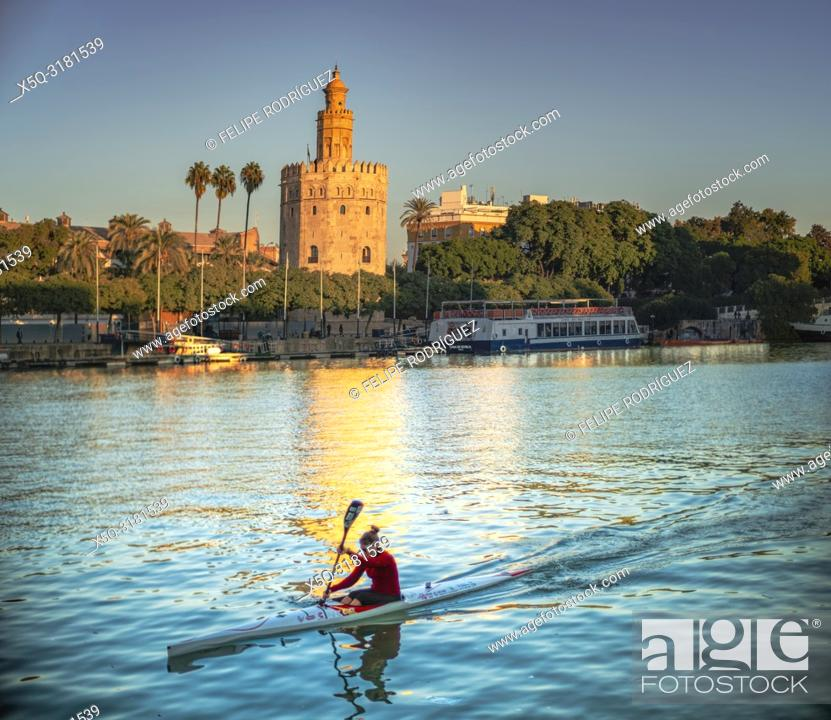 Stock Photo: Canoeist on the Guadalquivir river, in front of the Tower of Gold (12th century landmark), Seville, Spain.