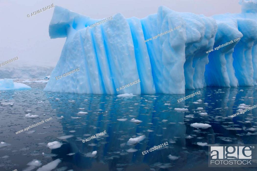 Stock Photo: Iceberg and azure water.