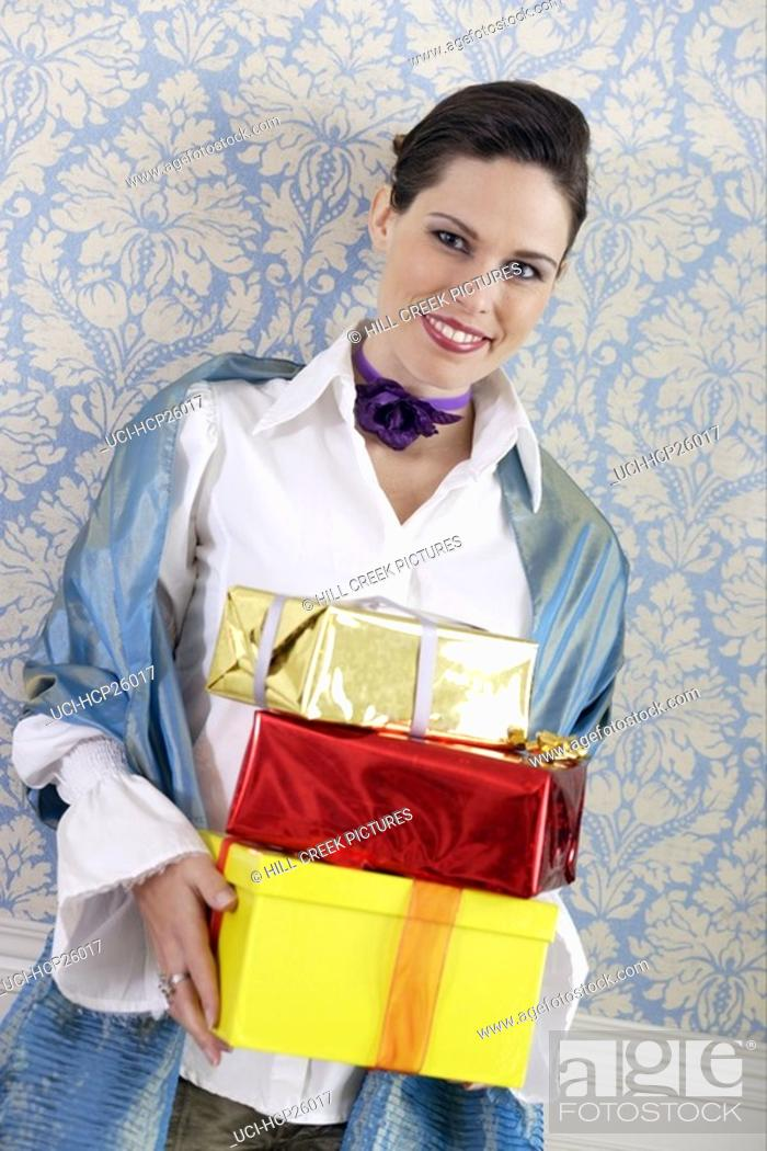 Stock Photo: Woman holding gifts.