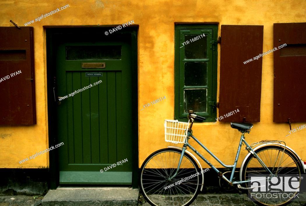 Stock Photo: Denmark, Copenhagen, Bicycle and Apartment Building.