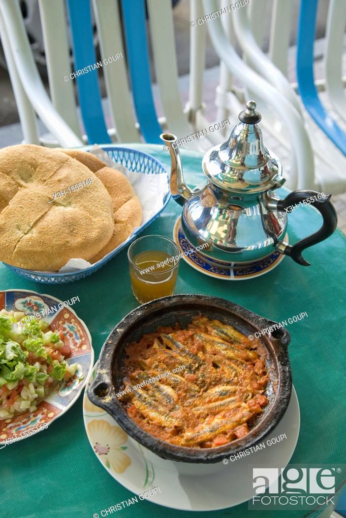 Stock Photo: anchovy tagine in a restaurant of Chefchaouen, Rif region, Morocco, North Africa.