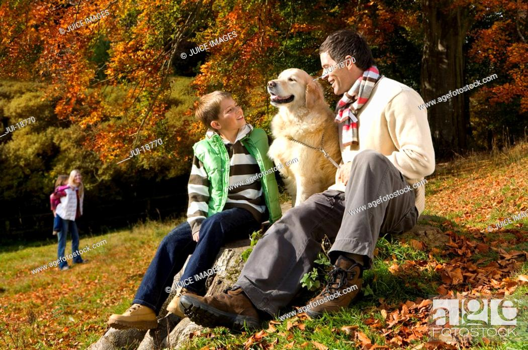 Stock Photo: Family and dog in woods.