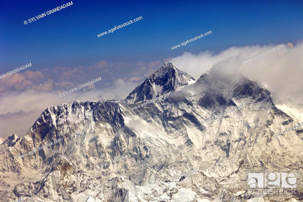 Stock Photo: Bhutan (kingdom of), aerial view ofthe Himalaya mountains chain while flying from Katmandu to Paro on a Druckair Airbus A219.