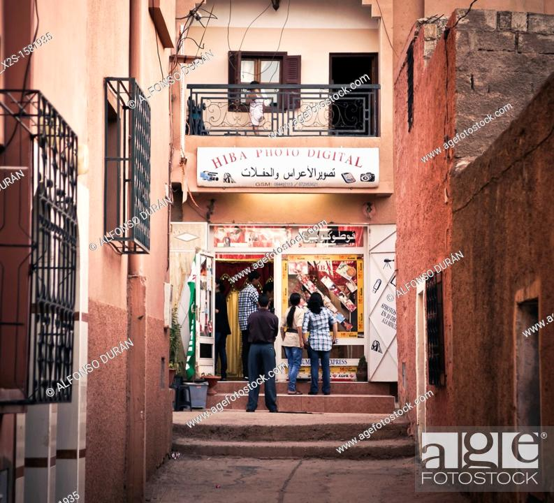 Stock Photo: boys looking at the window of the photo shop, Azilal, Morocco.