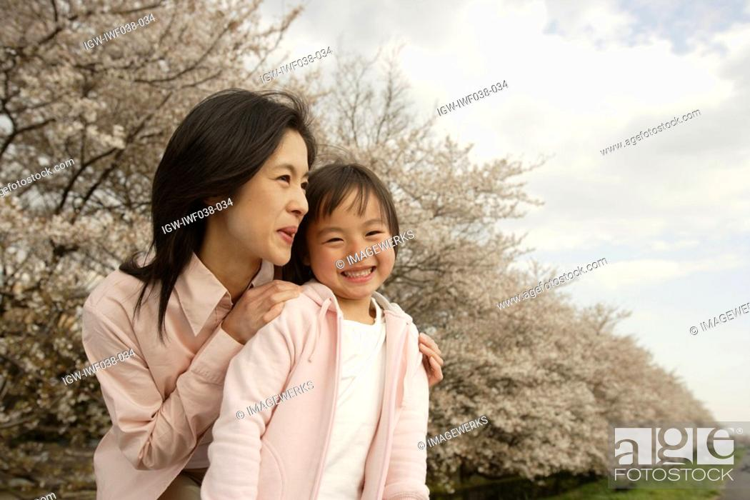 Stock Photo: Portrait of a mother and daughter smiling.
