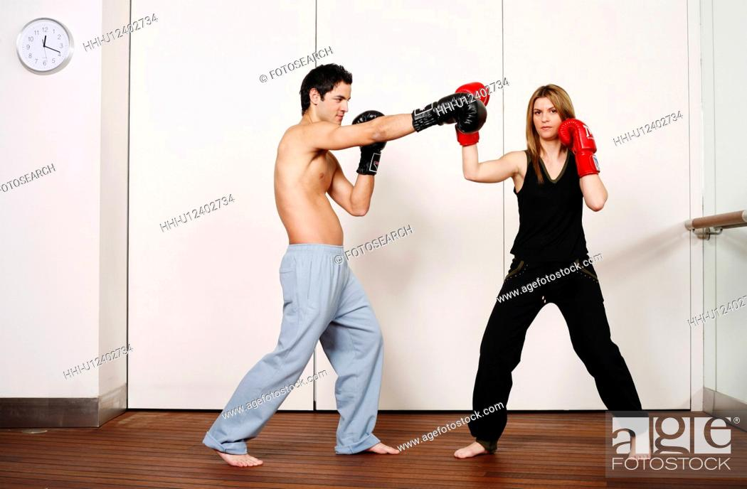 Stock Photo: Straight right-hand punch of Active Tae Bo and inside block.