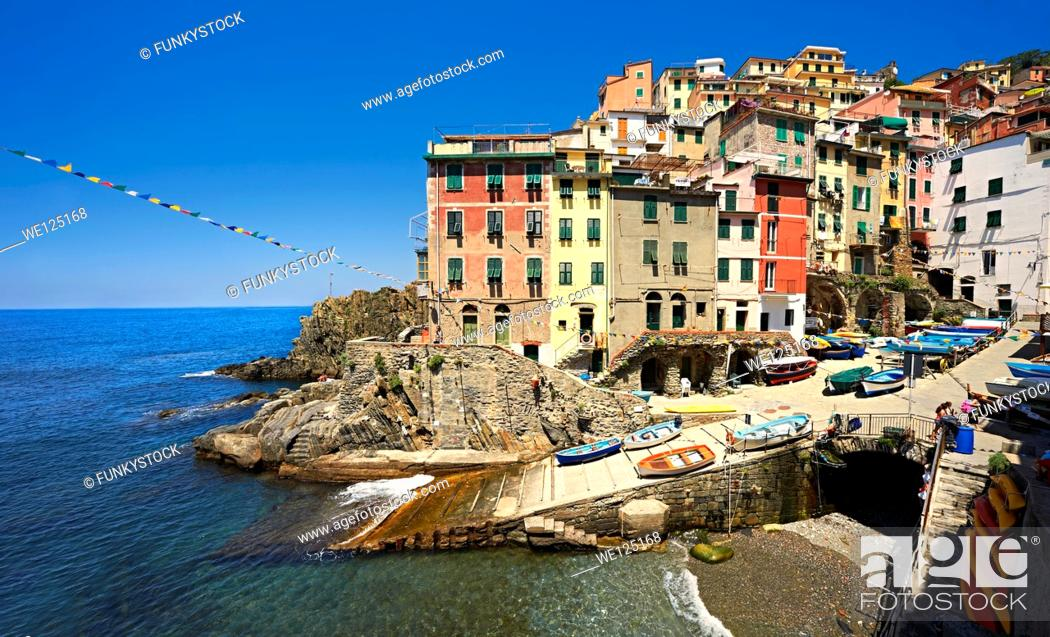 Stock Photo: Photo of the colorful houses of the fishing port of Riomaggiore, Cinque Terre National Park, Liguria, Italy.