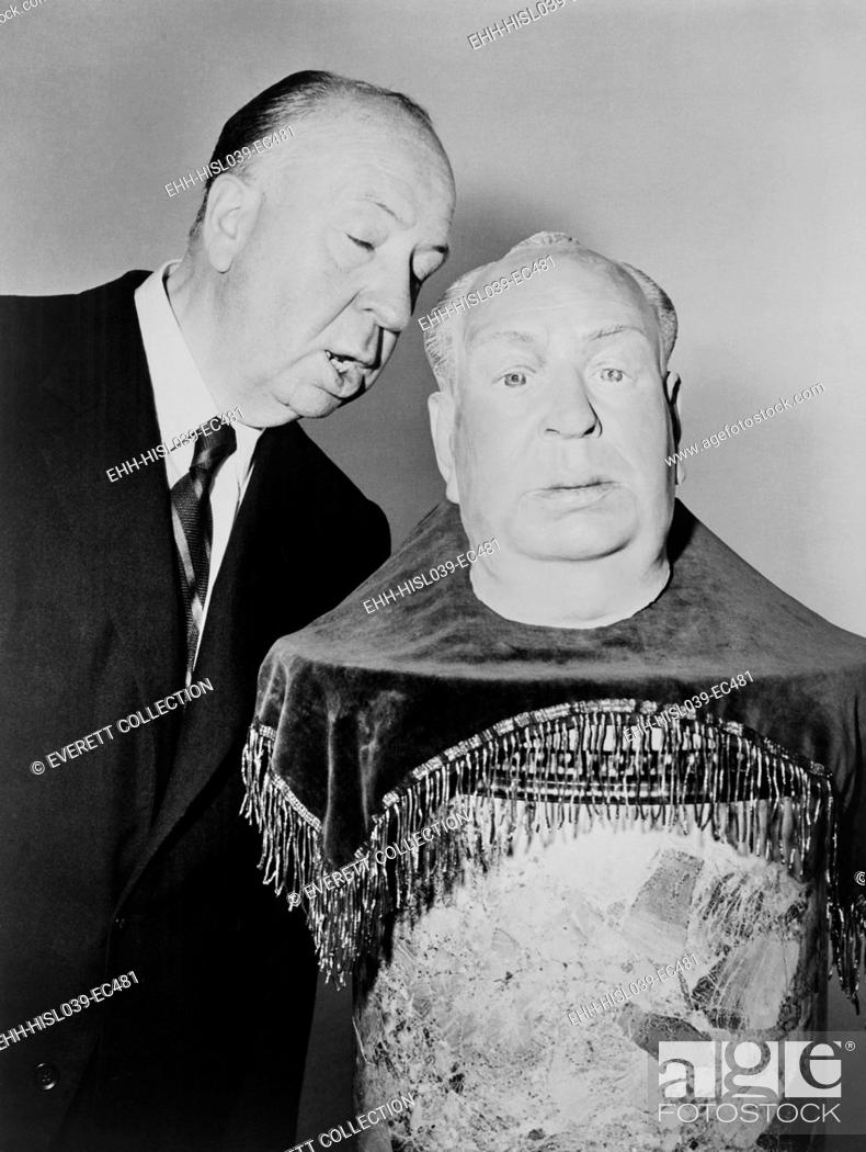 Stock Photo: Alfred Hitchcock whispering into the ear of a plaster sculpture of his head. It will be his stand-in as he begins shooting the fourth TV season premiere of.