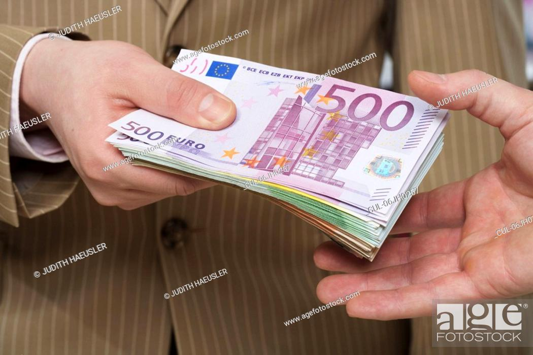 Stock Photo: Transferring money-notes.