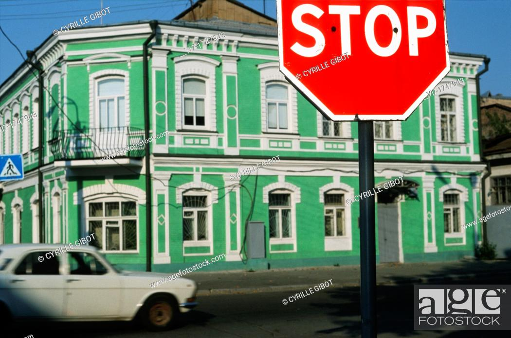 Stock Photo: Stop sign and green painted house, Podil district, Kiev, Ukraine.