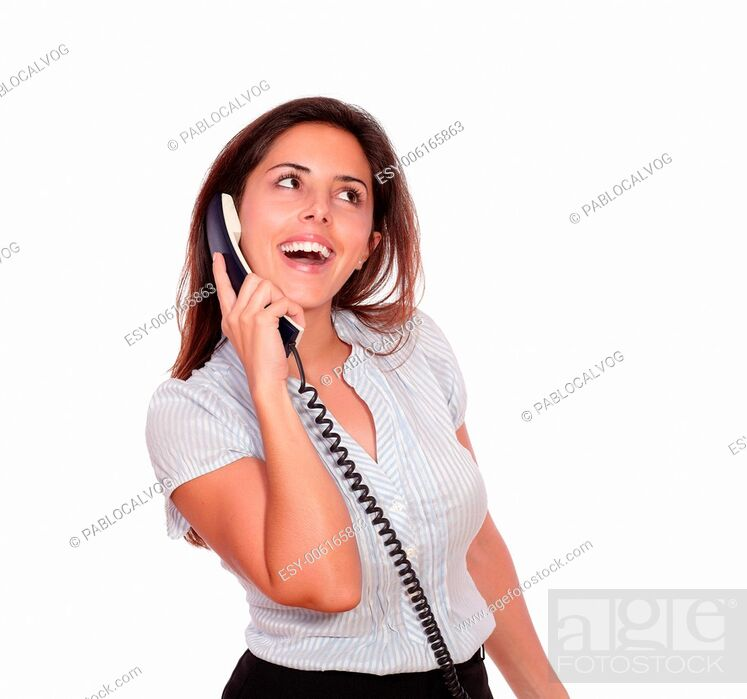 Stock Photo: Portrait of a smiling hispanic female talking on phone while looking up on white background - copyspace.