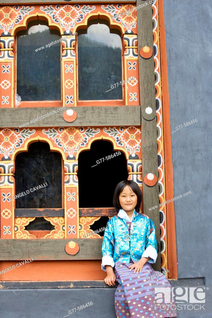 Stock Photo: Bhutan. Thimpu. Thimpu Dzong Monastery. Buddhist Festival (Tsechu). Bhutanese little girl.