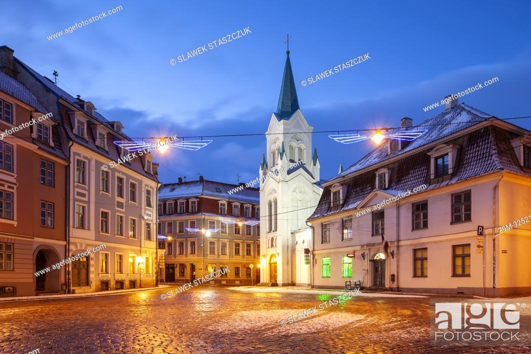 Stock Photo: Winter dawn at Our Lady of Sorrows catholic church in Riga old town, Latvia.