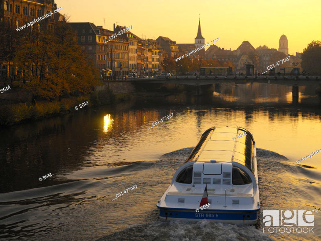 Stock Photo: Tourist boat on Ill river at sunset. Strasbourg. Alsace. France.