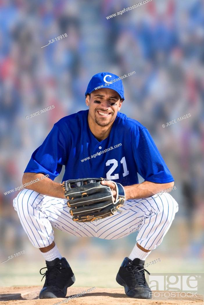 Stock Photo: Portrait of smiling baseball player.