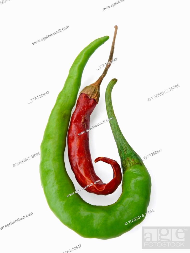 Stock Photo: Common Chili, Capsicum annuum, Red and green chilies are together.