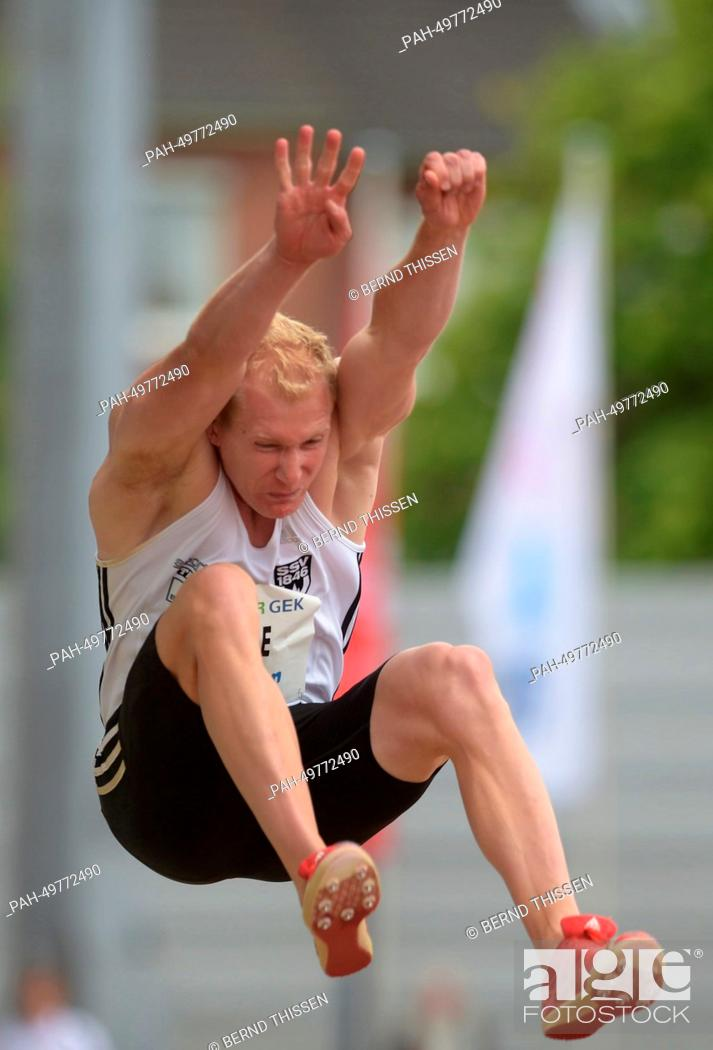 Stock Photo: German decathlete Arthur Abele during a long-jump at the athletics combined event meeting in Ratingen, Germany, 28 June 2014.