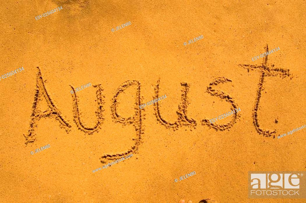 Stock Photo: Month August in the sand.
