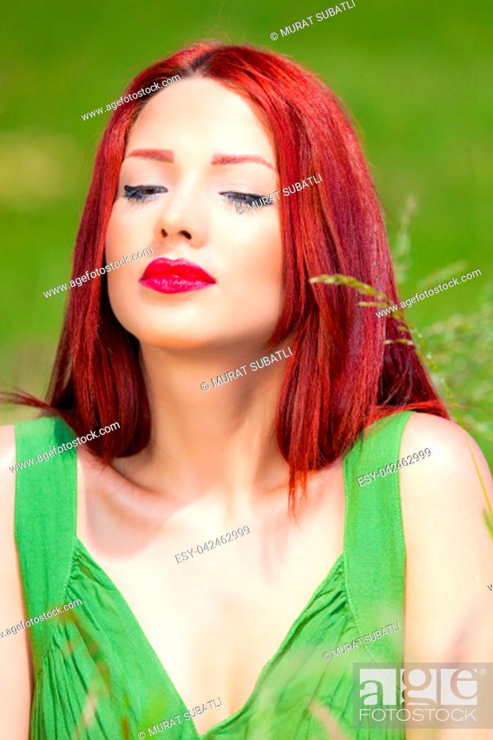 Stock Photo: Redhead is running on a country road.