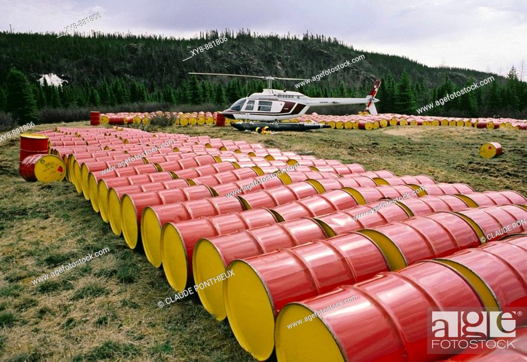 Stock Photo: Barrels, helicopters, James Bay Area. Quebec. Canada.