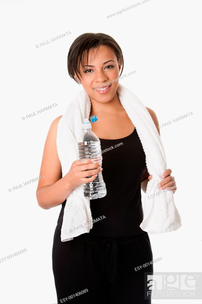 Stock Photo: Beautiful attractive happy young sweaty woman with water after exercise workout, rehydrating thirst quenching, isolated.