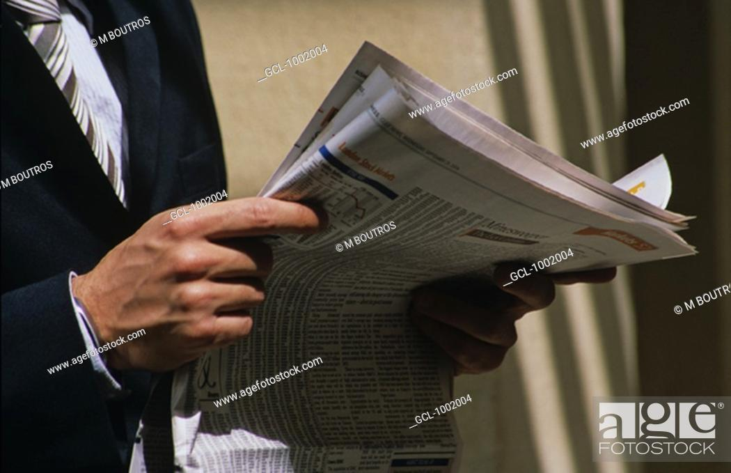 Stock Photo: Businessman reading the newspaper.