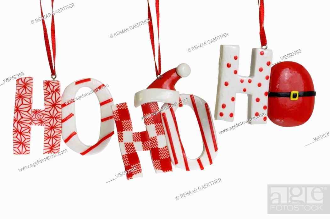 Stock Photo: Ho Ho Ho candy Christmas tree ornaments on a white background.