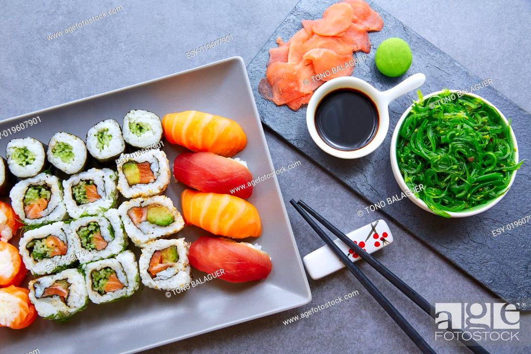 Stock Photo: Sushi Maki and Niguiri California roll with seaweed chuka salad soy sauce and wasabi.