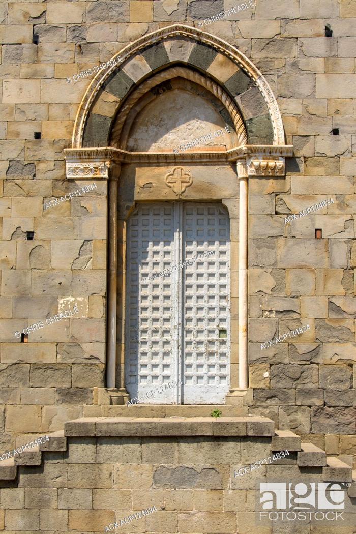 Stock Photo: Church side door at Chiesa de San Giovanni Battista, Riomaggiore, a village and comune in the province of La Spezia, situated in a small valley in the Liguria.
