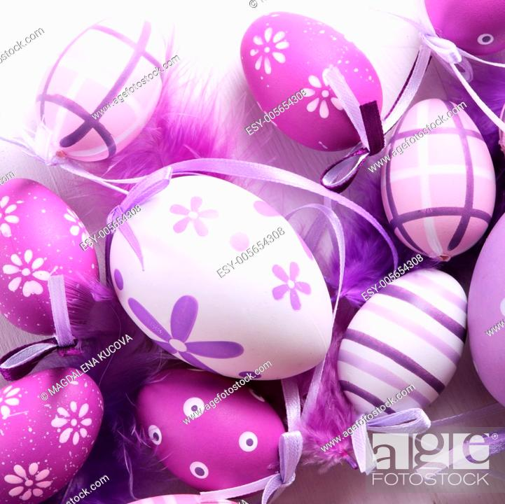Stock Photo: Close-up o Easter eggs and feathers.