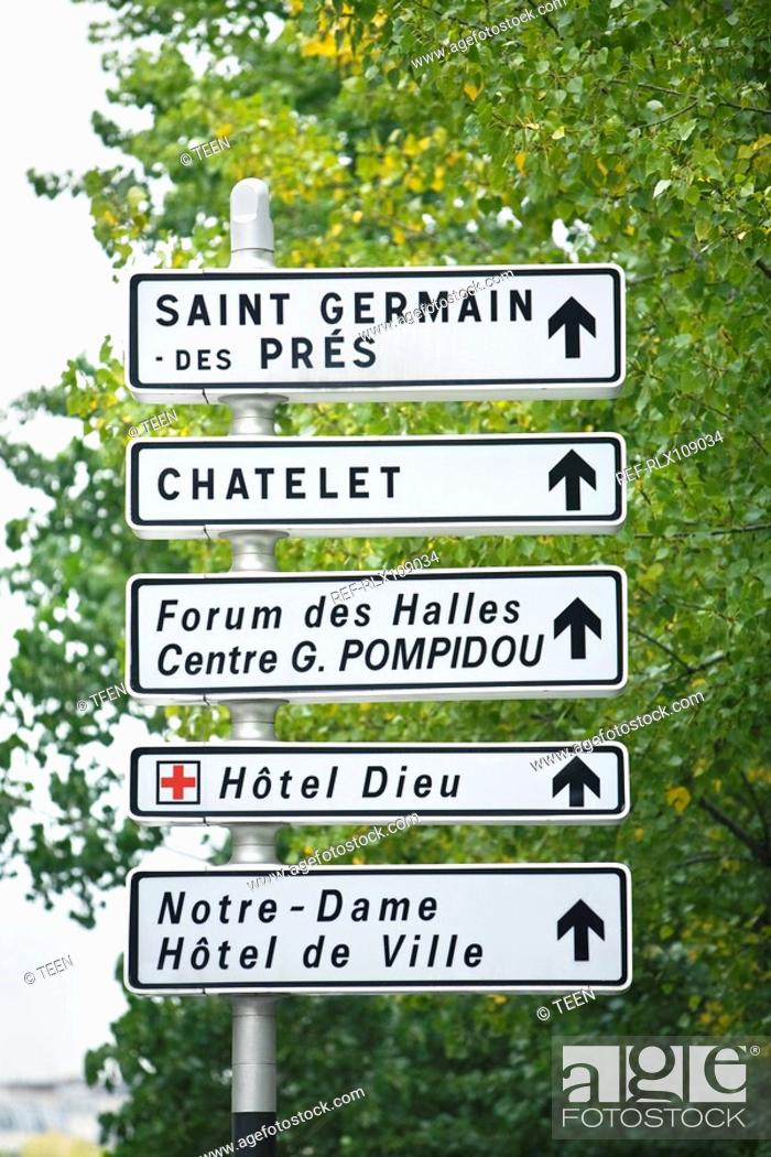 Stock Photo: Signpost showing tourist attractions, Paris, France.