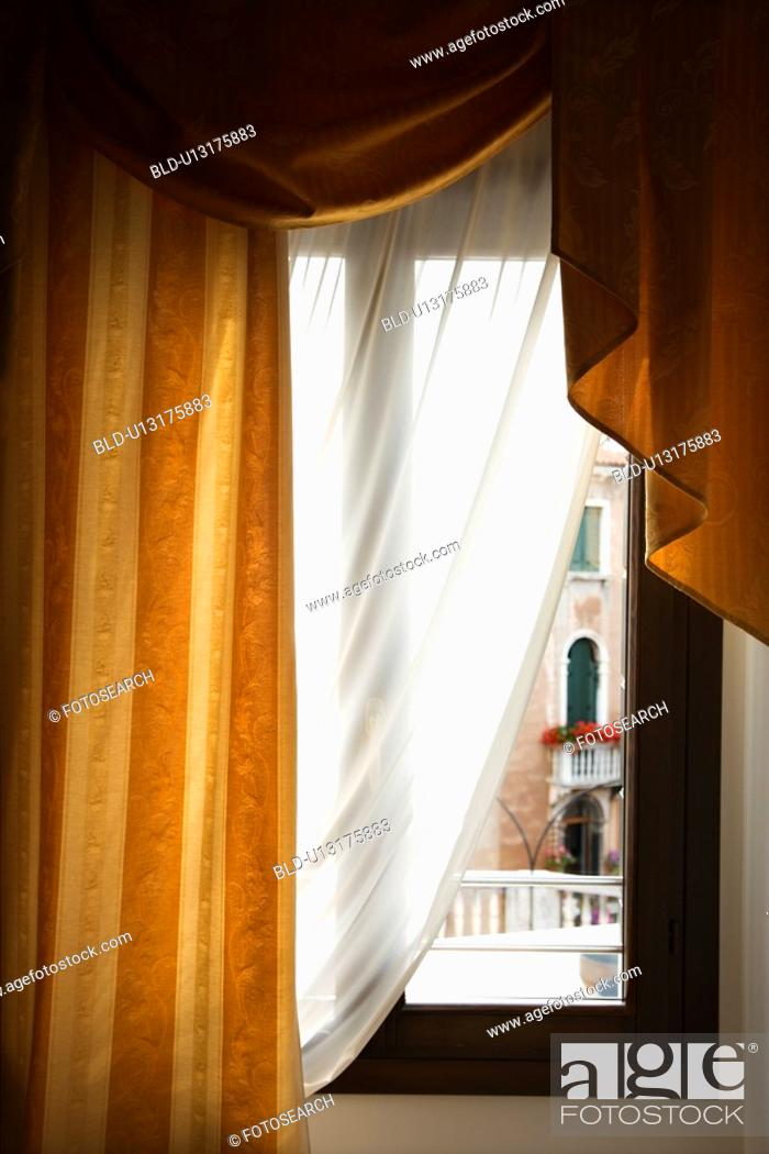 Stock Photo: Window with drapes in Venice, Italy.