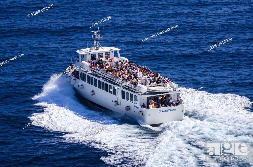 Stock Photo: Tour boat leaving the dock at Vernazza, Cinque Terre, Liguria, Italy.
