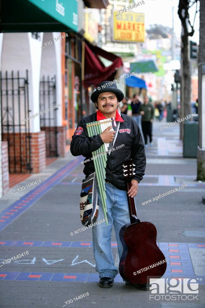 Stock Photo: Portrait of a hispanic musician on Mission Street, San Francisco, California, USA  Mission District is one of the most colorful neighborhoods of San Francisco.