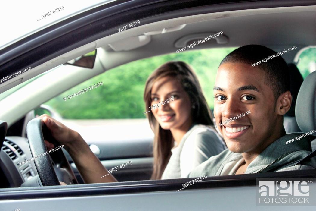 Stock Photo: Teenagers driving car.