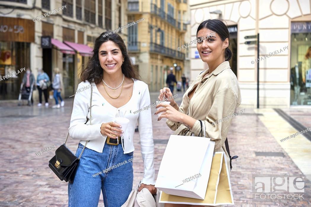 Stock Photo: Two young girls enjoying a morning of shopping.