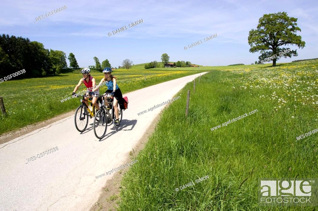 Stock Photo: Germany, Bavaria, Oberland, Two women mountain biking.