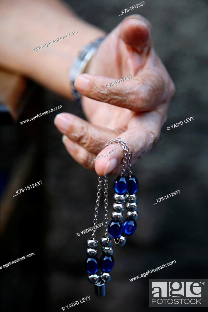 Stock Photo: Hand holding worry beads, Rhodes, Greece.