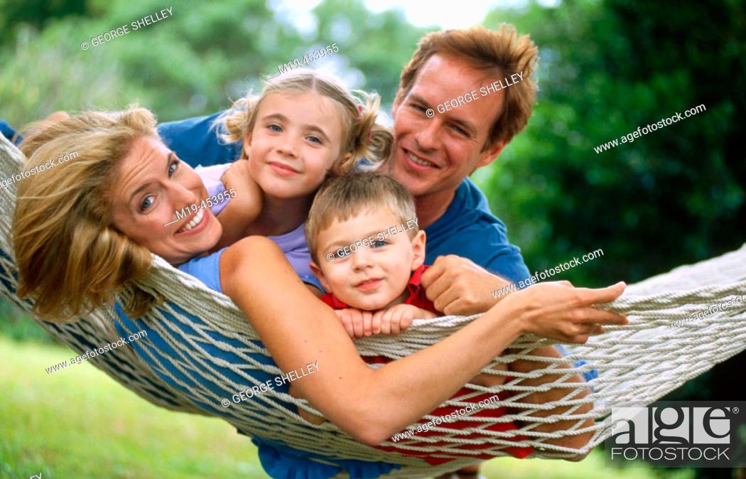 Stock Photo: family on a hamock.
