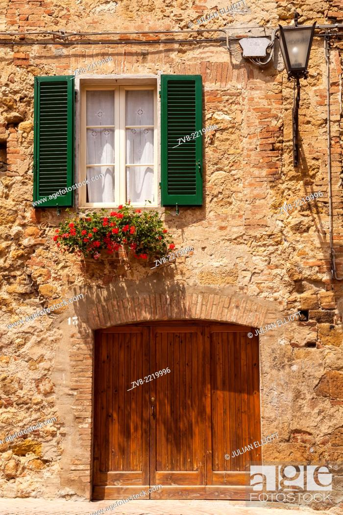 Stock Photo: An old house in Pienza, Tuscany. The town was declared a World Heritage Site by UNESCO in 1996. It lies within the Val d'Orcia which has also been designated a.