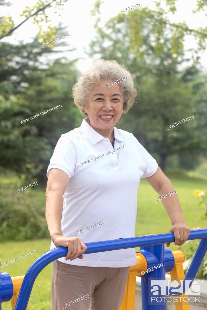 Stock Photo: Elderly woman outdoors, healthy life.