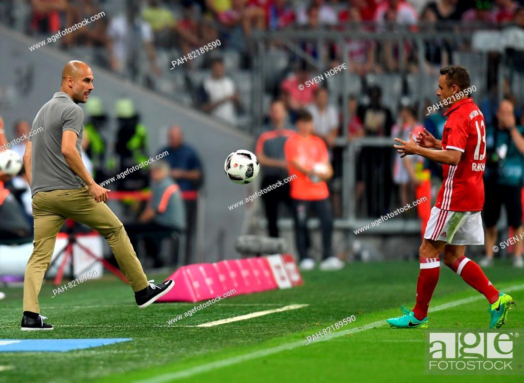 Manchester's head coach Josep 'Pep' Guardiola (L) passes the