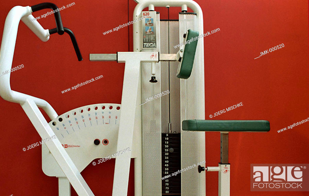 Stock Photo: Body-building machine, athletic implement at a gym, fitness center.