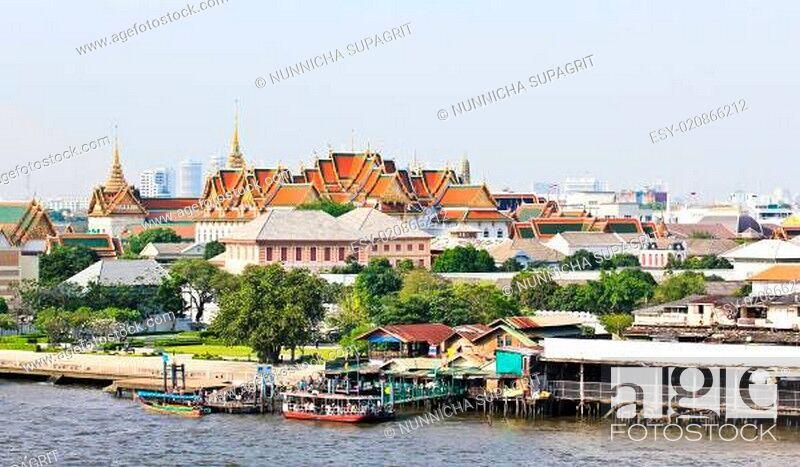 Stock Photo: Grand palace and the city of Bangkok along Chao Praya River.