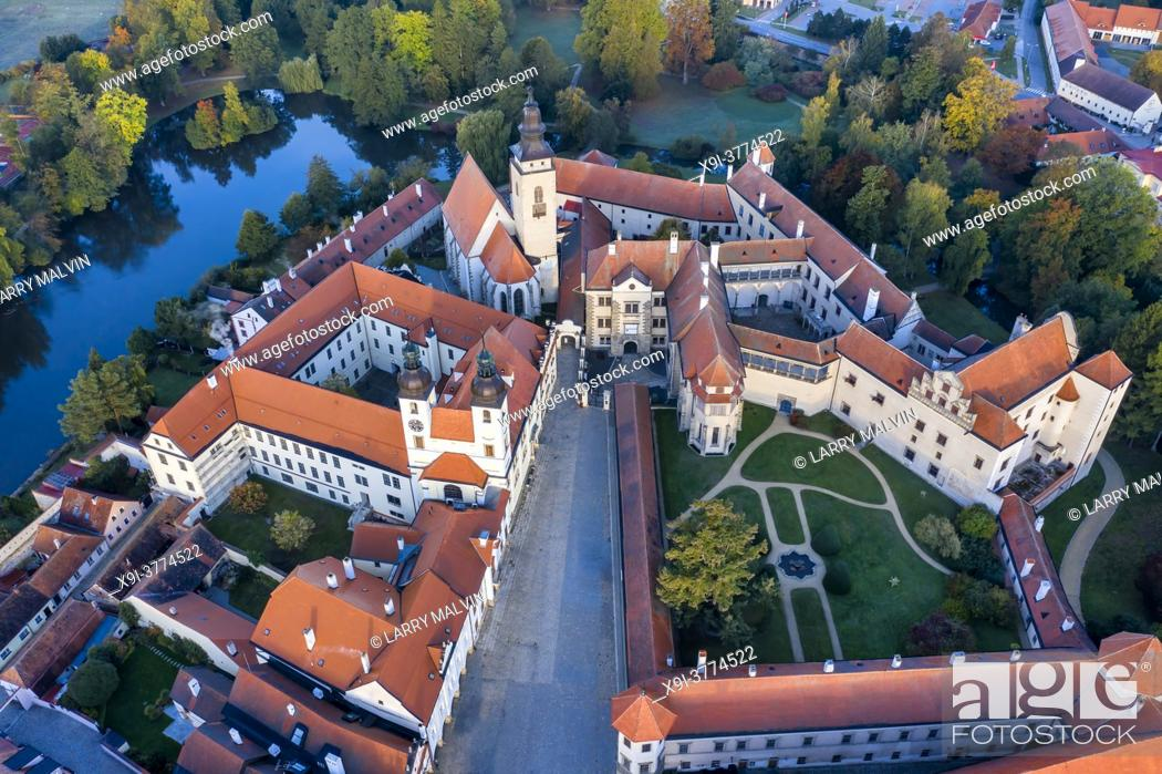 Stock Photo: Aerial view at sunrise of the Telc Castle with its three towers and grounds in the Czech Republic.