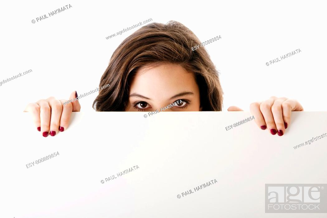 Stock Photo: Partial face of beautiful young caucasian brunette business student woman holding a white blank board, isolated.